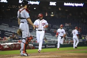 Harper drives in 100th run, Nationals beat Marlins 7-3