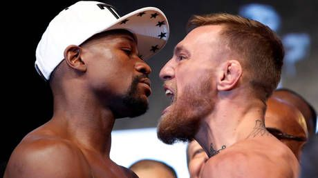 'Hate from my own people': Floyd Mayweather rants about 'racism' as he accuses 'bum' Conor McGregor of stealing from him