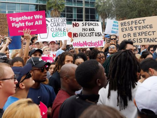 Florida declared a state of emergency before a white nationalist's speech - and protesters showed up with confetti, high-fiving state troopers