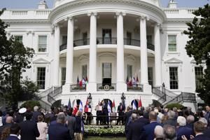 Investigated at home, FIFA head visits Trump, White House