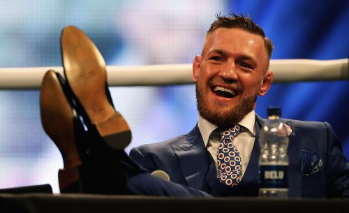 Conor McGregor's coach says the UFC star doesn't actually spend much money because his expensive clothes and cars are 'given to him'