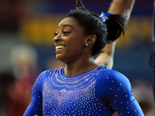 Simone Biles is dominating at the gymnastics world championships - despite having a kidney stone that sent her to the ER