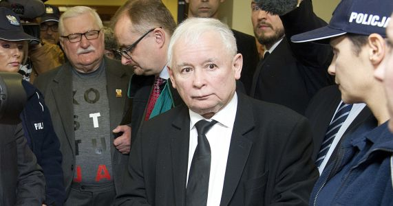Poland's Lech Walesa wears protest T-shirt to Bush funeral