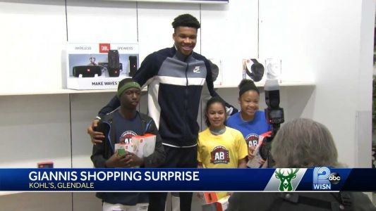 Giannis surprises student-athletes with shopping trip