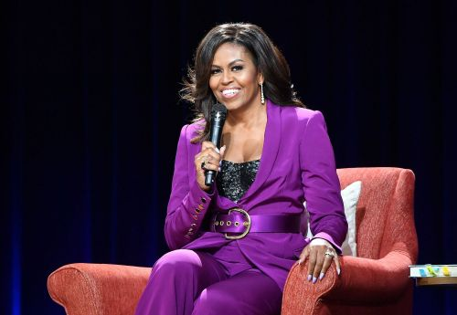 Michelle Obama wears a sequin bustier and purple suit on 'Becoming' book tour