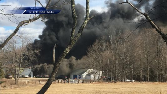 Road closed for fire at commercial building in Greenland