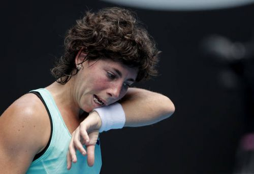 The Latest: Suarez Navarro into Australian Open quarters