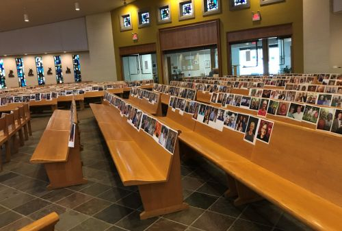 Pastor puts pictures of church's congregation in pews to make them feel like they were there
