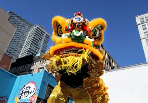 Lion Dance Parade Celebrating The Year Of The Pig