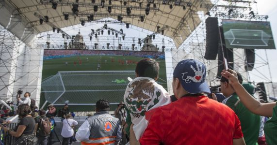 Mexican soccer fans and pride marchers mingle in celebration