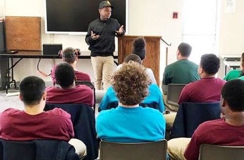 Hip-hop artist shares life story with charter school students