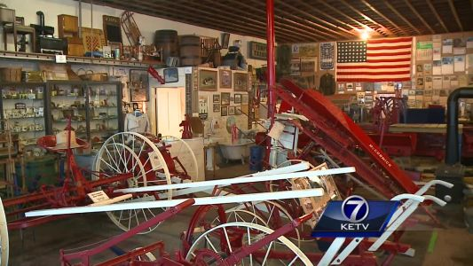 Antique IH farm display fills Griswold, IA storefront