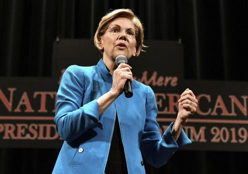 Elizabeth Warren apologizes for heritage claim, woos Native Americans