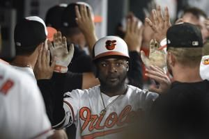 Orioles hit 4 HRs off Nova, beat White Sox 9-1 to end skid