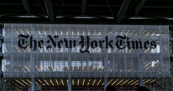 Trump escalates attacks on The New York Times, calling it a 'true enemy of the people'