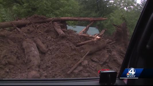 Woman found dead after home was knocked off foundation in WNC mudslide