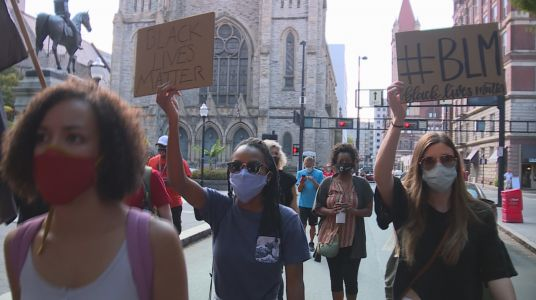 Families of police shooting victims march in Cincinnati, call for change