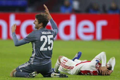 Thomas Muller was given a red card for a flying kick so wild it left his opponent needing medical treatment