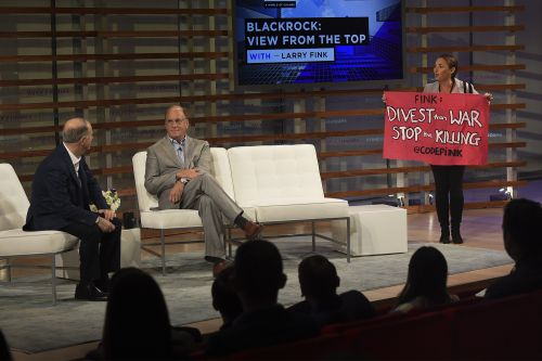 Larry Fink blitzed by war protesters at conference