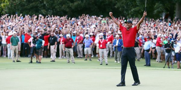 Tiger Woods completes first win since 2013 as celebrating crowd mobs the course in surreal scene