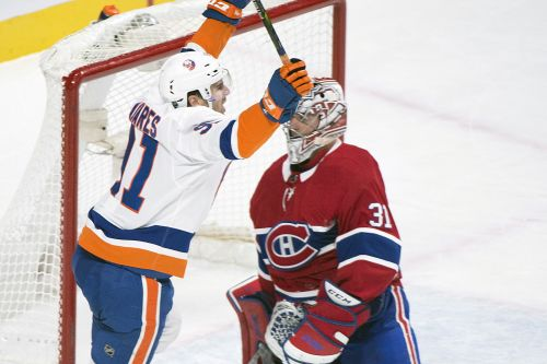 Islanders escape with overtime win after blowing two-goal lead