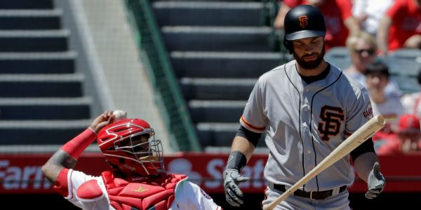 A Giants player set a new MLB record with a 21-pitch, 13-minute at-bat that included 16 foul balls - and it ended in a routine fly ball