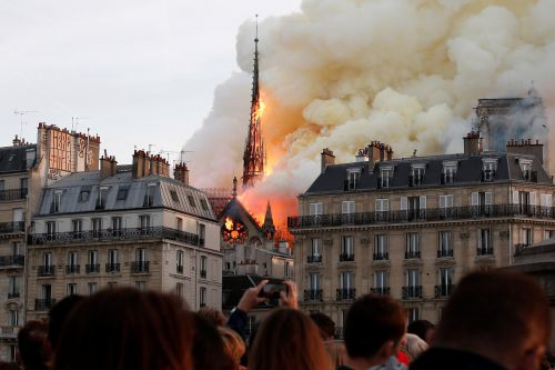 Tourists ran for their lives as Notre Dame blaze erupted