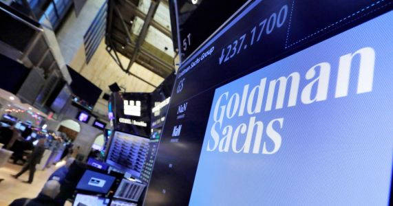 Goldman reports 26 percent surge in profits, helped by taxes