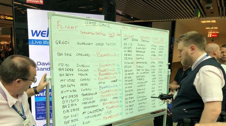 Chaos at Gatwick airport as flight info displayed on whiteboards amid screen glitch