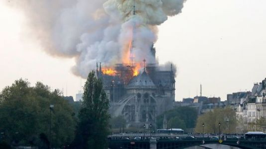 Spire Falls At Paris' Notre Dame As Cathedral Is Engulfed In Flames