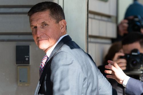 Michael Flynn arrives in court to be sentenced for lying to the FBI