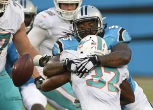 McCaffrey's run highlights Panthers' 27-20 win over Dolphins