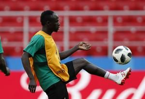The Latest: Sanchez gets 1st red of World Cup; Japan scores