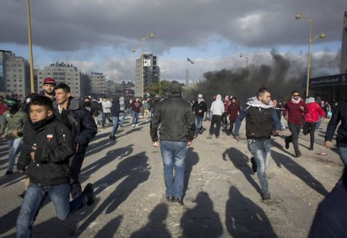 The Latest: Palestinians, Israeli troops clash in West Bank