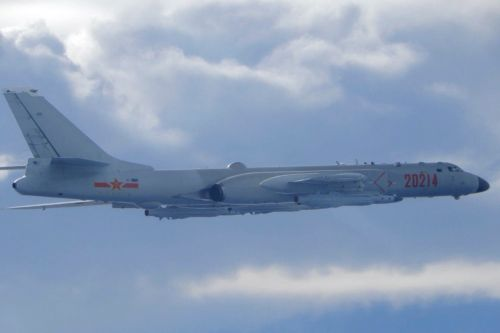 China flies 18 warplanes near Taiwan during U.S. envoy's visit