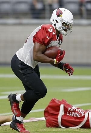 Cardinals' Johnson strong in debut, 'encouraged' about deal