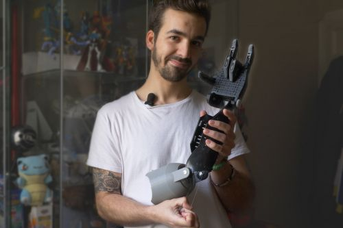 This toymaker crafts robot arms for orphans