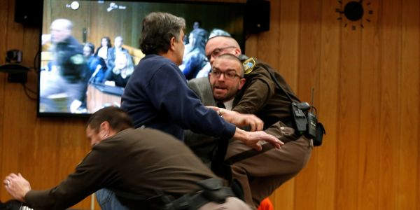 Father of 3 victims of Larry Nassar lunges at disgraced doctor in court room