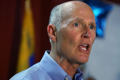 Rick Scott wants to raise age to buy guns and put cops in every school