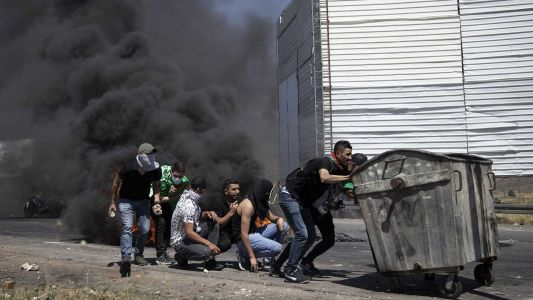 Hundreds of demonstrators clash with Israeli troops amid more Israel-Hamas fighting
