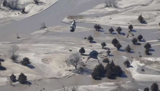Nebraska Army National Guard air-dropping hay bales to livestock stranded by flooding