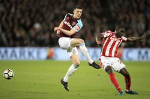Carroll equalizes late as West Ham holds Stoke to 1-1 in EPL