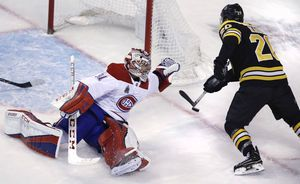 Bruins beat Canadiens 4-1 in coach Julien's return to Boston
