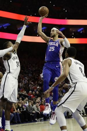 Dinwiddie scores career-best 39, Nets top 76ers 127-124