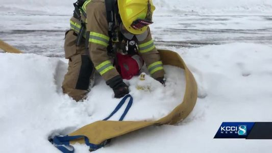 Firefighters have trouble getting to snow-covered hydrants