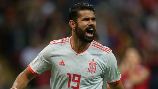 Diego Costa breaks Iran's wall and hearts as shaky Spain survive World Cup scare