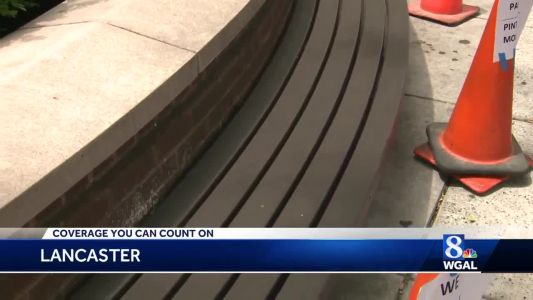 Commissioners give OK to install handles on benches outside government center