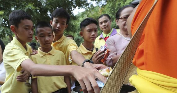 Thai cave boys mark year since ordeal with Buddhist rites