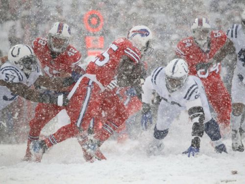 Bills and Colts play in a whiteout after snow takes over Buffalo stadium - and fans can barely see the field