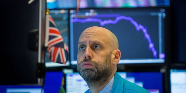 Dow plummets 500 points as spiking virus cases prompt more lockdowns